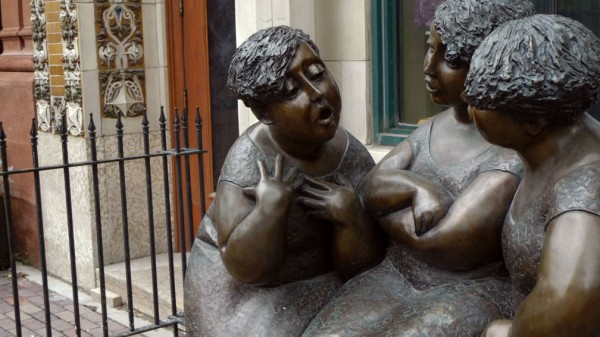 Statues Chatting by Blaise MacMullin
