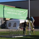 Hanging up the welcome banner